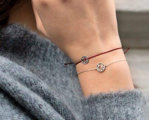 Xenox Weltkugel Armband Anhänger Kette Ohrringe Juwelier Rohrbach
